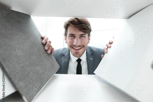 businessman smiling and looking at camera Wallpaper Mural