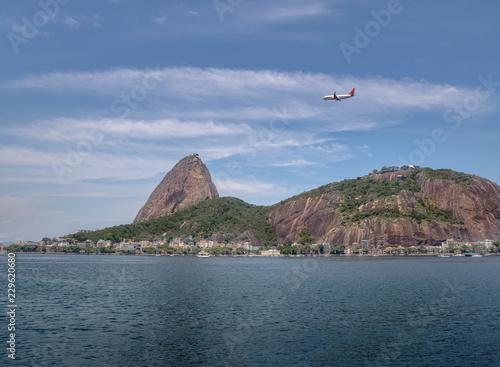 Plane flying over Sugar Loaf Mountain - Rio de Janeiro, Brazil