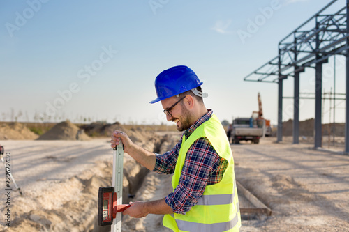 Construction worker with laser receiver