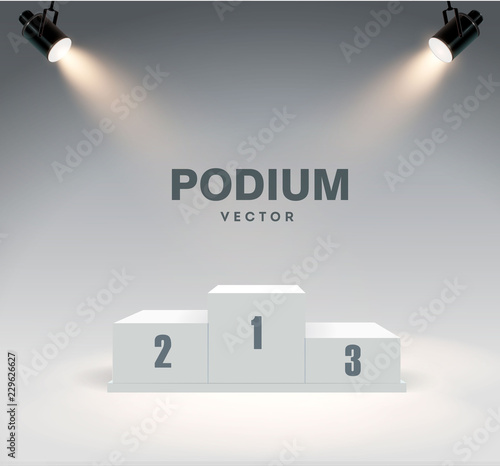 Foto Round podium illuminated by searchlights