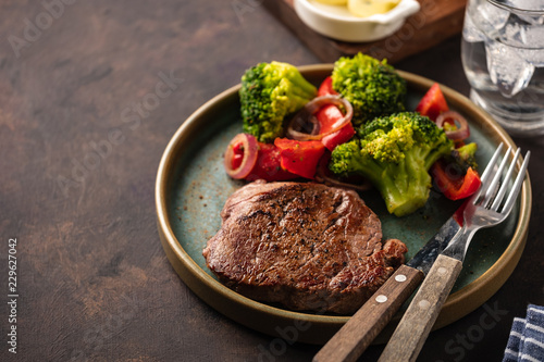 Grilled Beef steak with vegetables. Meat with grilled bell pepper, broccoli and onions