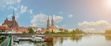 Wroclaw Poland View At Tumski Island And Cathedral Of St John The Baptist, River Odra.  The Bright Rays Of The Sun Shine On The Tumsky Island.