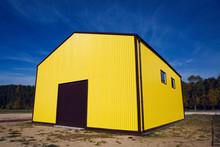 Yellow Metal Building At Lake Garage In Autumn