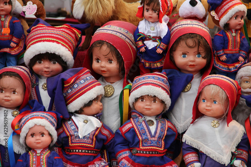 Fotografie, Obraz  A collection of Saami dolls dressed in traditional Lapland clothing, sold as souvenirs in Finland