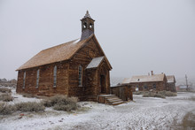 Old Wooden Church In An Abandoned Mining Town Gets Covered In The Fresh Snow.