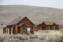 Abandoned Wooden Cabins Slowly Decay In The Tough Weather In Californian Wild.