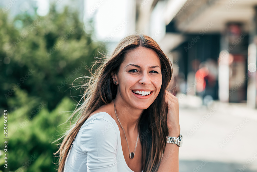 Fototapety, obrazy: Portrait of gorgeous smiling young woman outdoors.