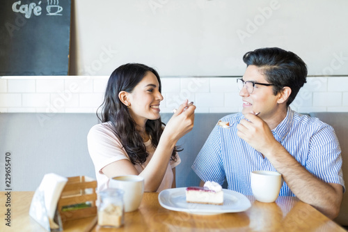 Couple In Love Having Cake At Cafe Canvas Print