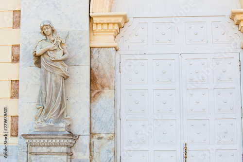 Fotobehang Zuid-Amerika land Terpsichore muse statue at the facade of the Adolfo Mejia theater in Cartagena de Indias