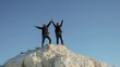 two men tourists hiking adventure climbers climb the mountain success hand to hand freedom up. slow motion video. hiker walking goes on nature on the hill white rock. extreme outdoor activity sport