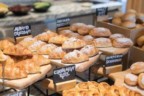 A variety of fresh croissant homemade in luxury hotel breakfast buffet, restaurant interior.