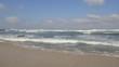 Waves crashing on the shore.
