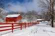 canvas print picture - Agriculture and rural life at winter background.Rural landscape with red barn, wooden red fence and trees covered by fresh snow in sunlight. Scenic winter view at Wisconsin, Midwest USA, Madison area.