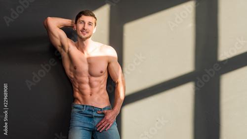 Fotografie, Obraz  Man with torso, muscular macho with six packs, dark background