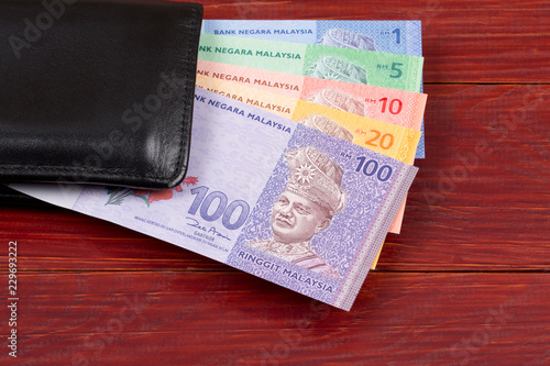 Fotografía  Malaysian money in the black wallet