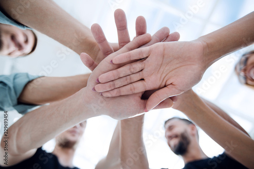 Fototapety, obrazy: Multiracial Group of Friends with Hands in Stack