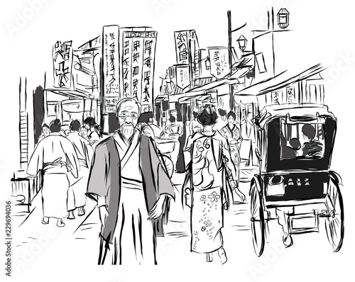 Street in Tokyo with people in traditional dress