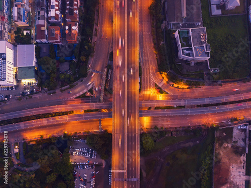Fototapeta Aerial view of highway junctions. Bridge roads shape letter x cross in structure of architecture concept. Top view. Urban city, Bangkok, Thailand. obraz na płótnie