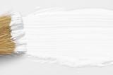 White paint stroke and brush