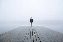 Young Woman Standing Alone On ...