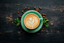 Cappuccino. Coffee With Milk. On A Black Wooden Background. Top View. Free Copy Space.