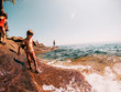 Father and Three children at the edge of a lake, Lake Superior, United States