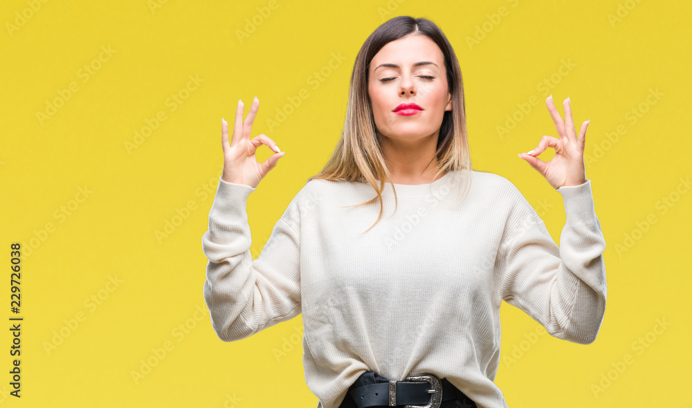 Fototapety, obrazy: Young beautiful woman casual white sweater over isolated background relax and smiling with eyes closed doing meditation gesture with fingers. Yoga concept.