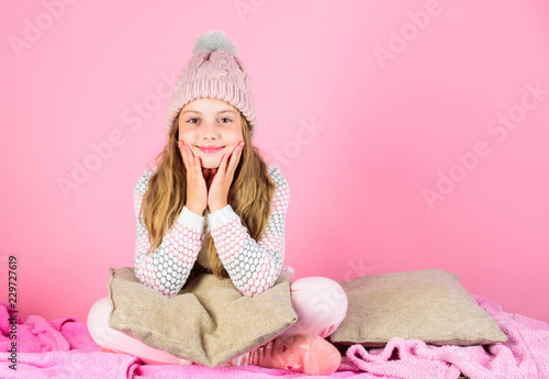 Fotografie, Obraz  Kid girl wear cute knitted fashionable hat and comfortable cozy clothes