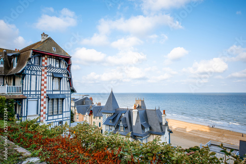 Top view of Trouville city with luxury houses and beautiful beach on the background during the morning light in France
