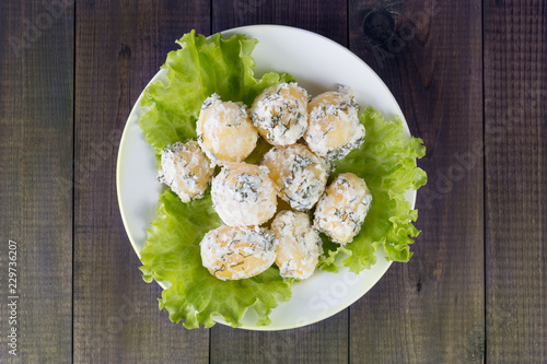 Fototapeta Boiled potatoes with sour cream and dill on the plate top view obraz