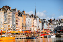 Waterfront With Beautiful Old Buildings In Honfleur, Famous French Town In Normandy