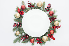 Top View Of Pine Tree Wreath With Christmas Decorations And Round Blank Space In Middle Isolated On White