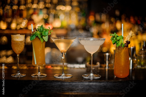 Set of classic cocktails: Dirty Martini, Sherry Cobbler, Brandy Crusta, Margarita and Cobras Fang