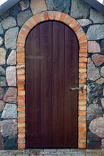 Old Wooden Door Standing In Stone