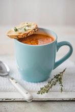 Tomato Soup In A Blue Mug With Creme Cheese Baguette And Thyme
