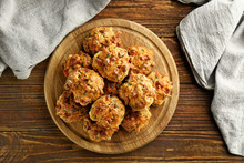 Wooden Board With Tasty Sausage Balls On Table, Top View