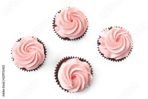 Photo  Sweet cupcakes on white background