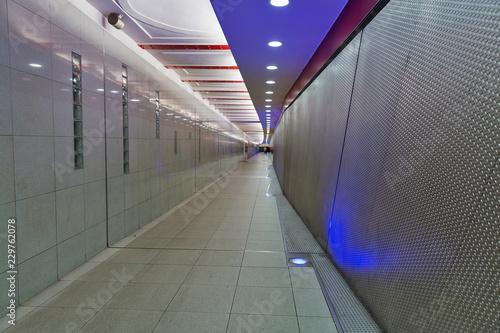 Deurstickers Tunnel long pedestrian tunnel in underground station