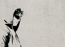 Sad Troubled Teenager School Boy With Hood Posing Alone . Image Made Like Graffiti Stencil Painting On White Concrete Wall With Copy Space For Writing - Stock Image