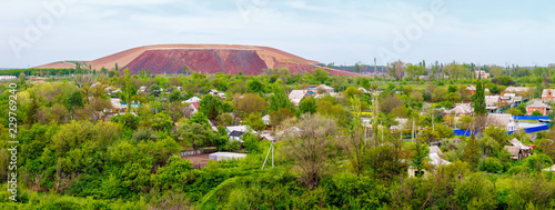 The panoramic view of the small village with the big coal mine waste heap in the background Canvas Print