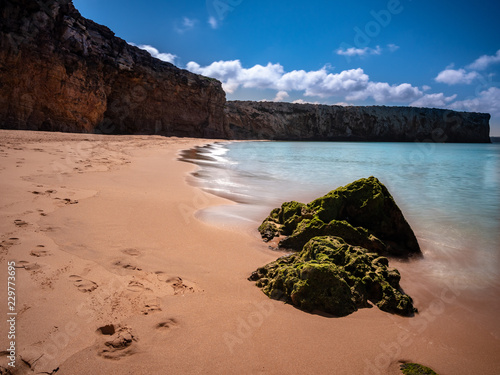 Beautiful view on beach near Sagres at the atlantic ocean Portugal Europe. The Coastline is used by Portugiese and tourists to chill or for big wave surfing. Popular destination for road trips.