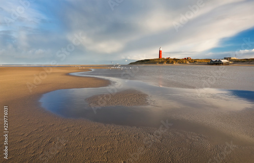 high tide on North sea coast with lighthouse