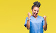Leinwandbild Motiv Young braided hair african american girl professional nurse over isolated background very happy and excited doing winner gesture with arms raised, smiling and screaming for success