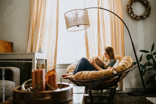 Woman Reading at home Wallpaper Mural