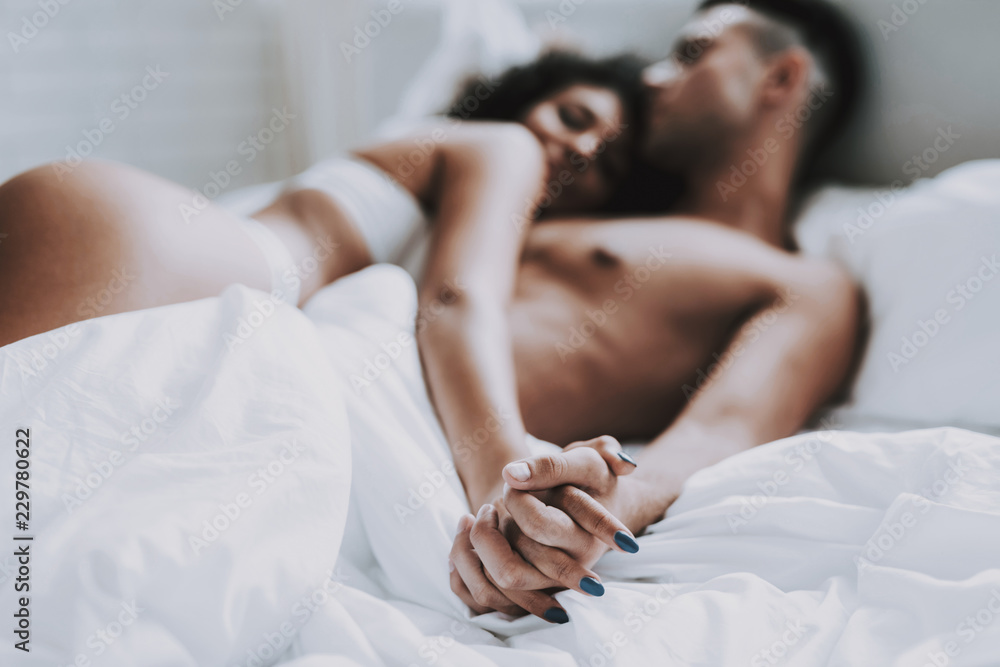 Fototapety, obrazy: Young Beautiful Couple in Underwear Lying on Bed