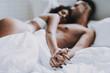 Leinwandbild Motiv Young Beautiful Couple in Underwear Lying on Bed