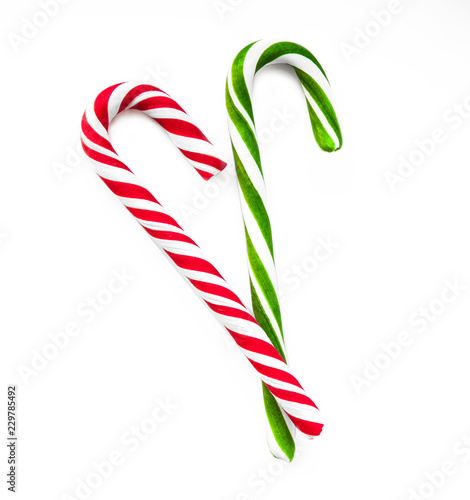 Сandy cane striped in Christmas colours isolated on a white background