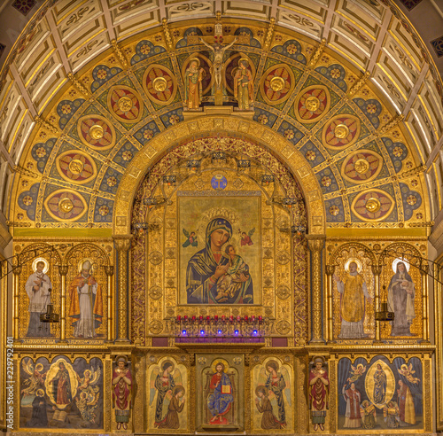 ZARAGOZA, SPAIN - MARCH 1, 2018: The main altar in church Iglesia del Perpetuo Socorro with the paintings by pater Jesus Faus (1953 - 1959).
