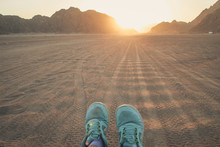 Desert In Egypt. Sharm El Sheikh. Sand And Sand Borkhan. Rock And Sunset. Ladies Feet In Sneakers. Girl's Feet