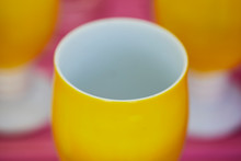 Close Up Of A Yellow Cup